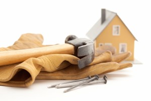 533506-hammer-gloves-nails-and-house